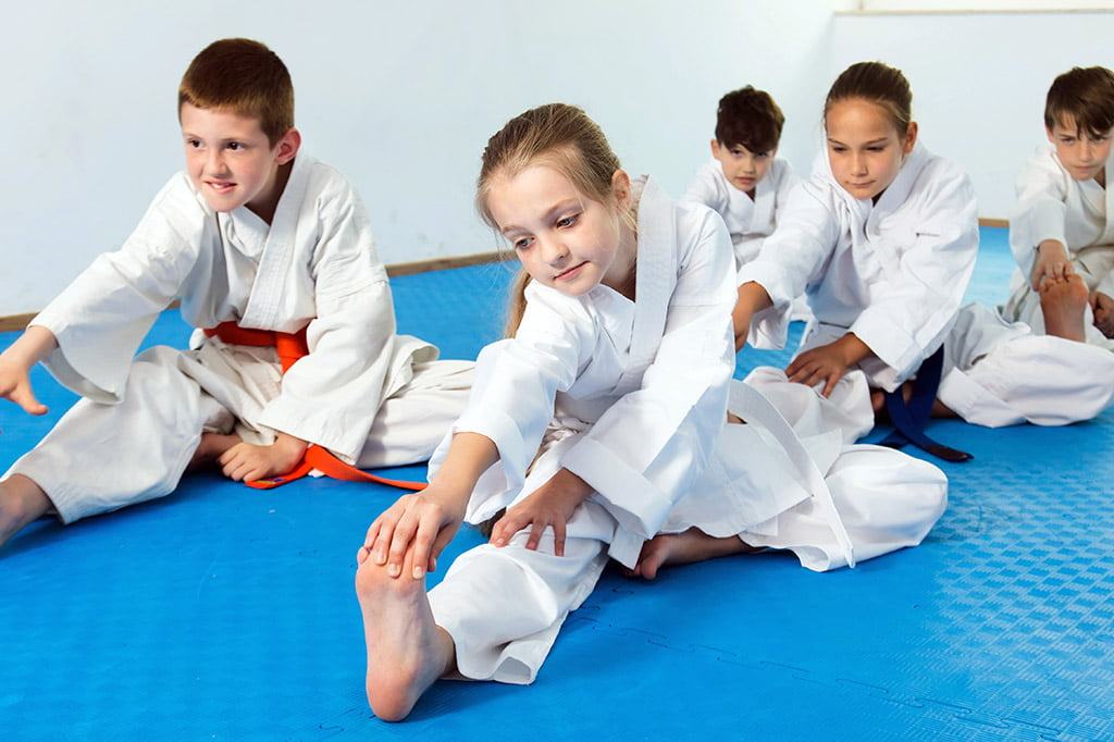 Bernardo Karate students doing warm up stretches