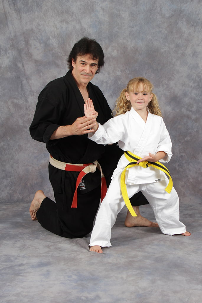 Michael Bernardo posing with young student