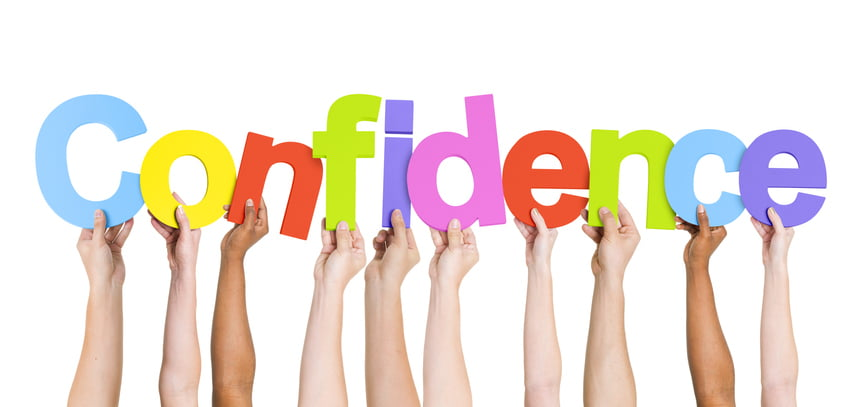kids hands holding up letters to spell confidence