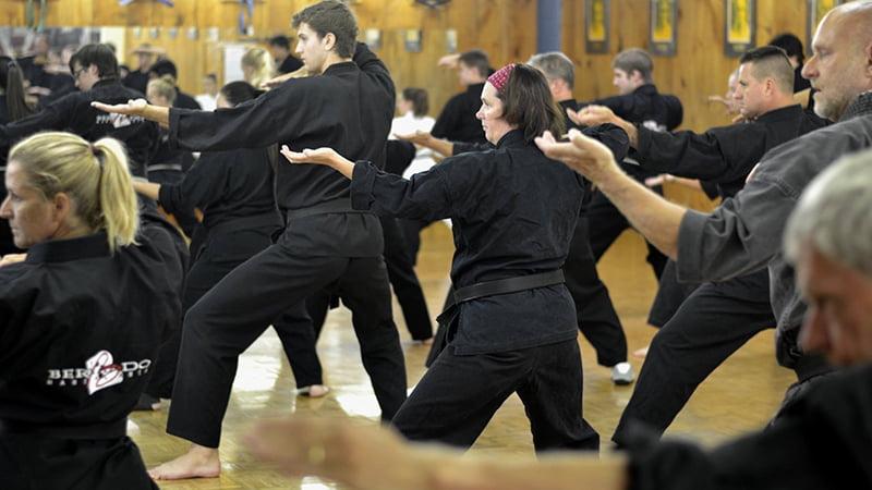 black belts practicing for grading