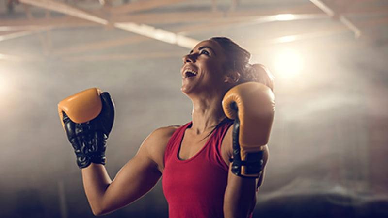 Happy women wearing boxing gloves