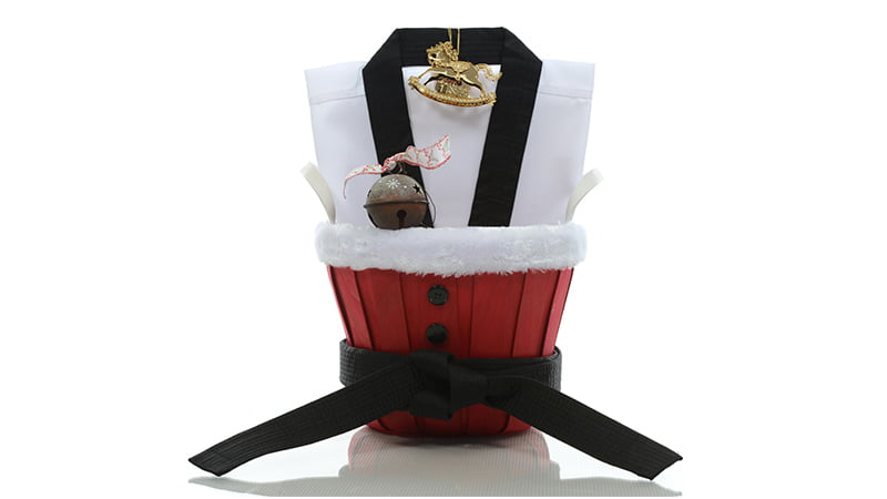 Christmas basket with Christmas decorations, and a karate Gi and black belt inside